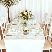 Table set up with White Cheltenham Chairs